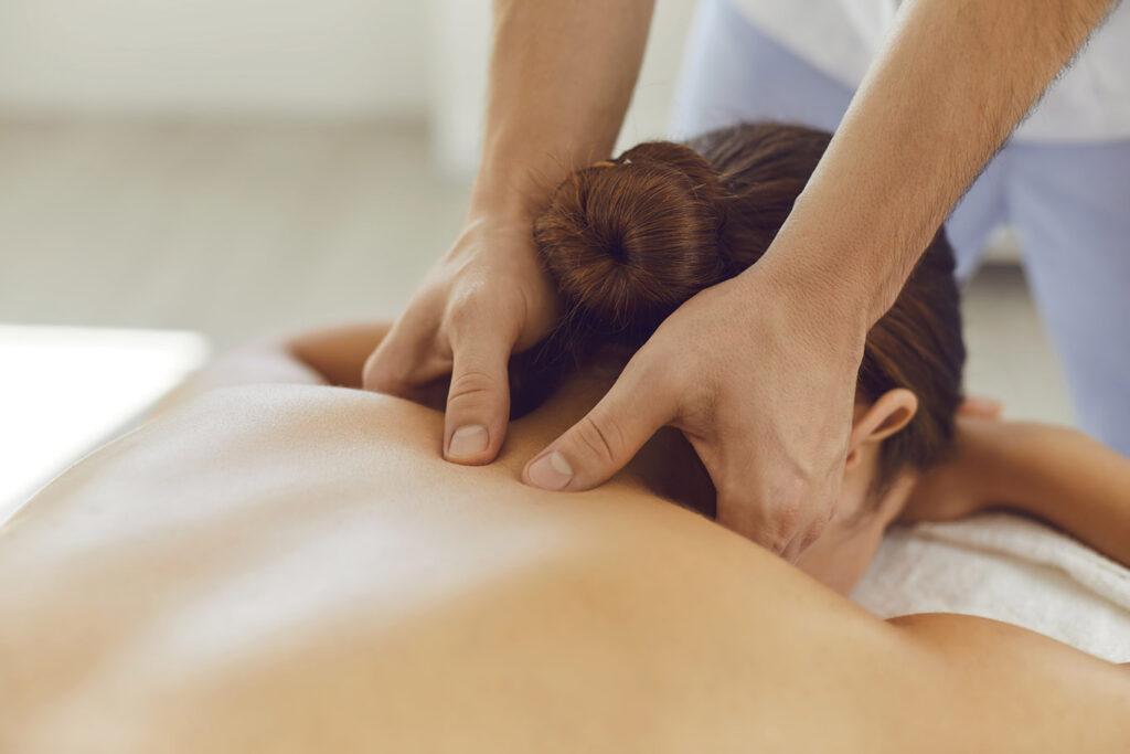 A woman receives a shiatsu massage