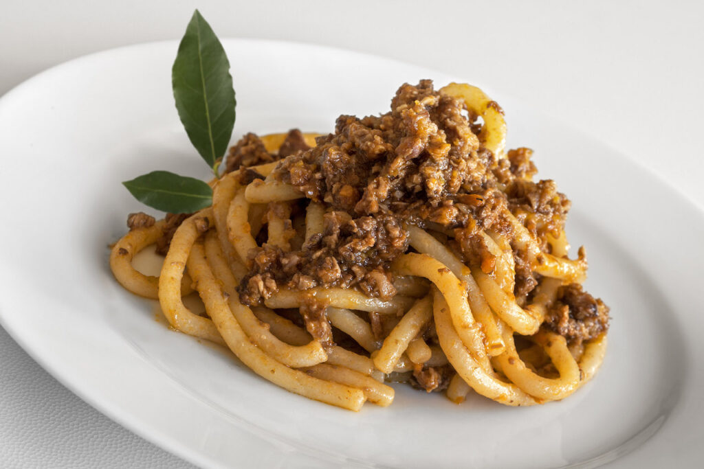 Homemade pici with meat sauce
