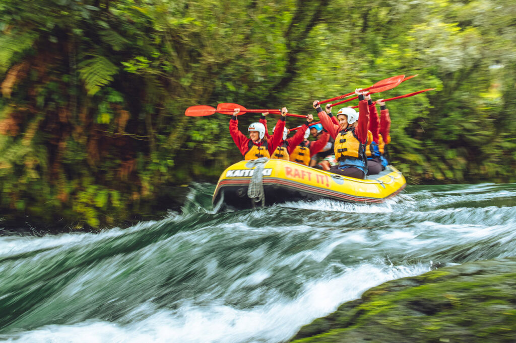 A group of people practicing Rafting in a river, Umbria.
