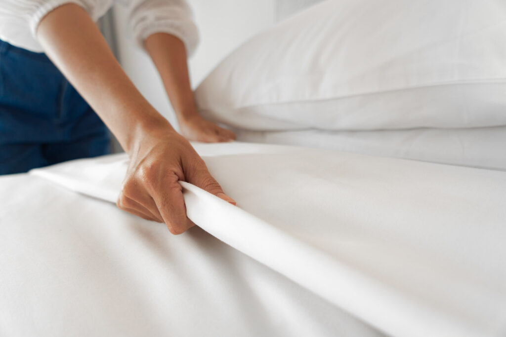 A woman who makes the bed