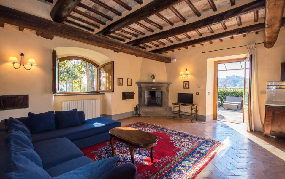Living room of the Scuderia apartment with a splendid stone fireplace